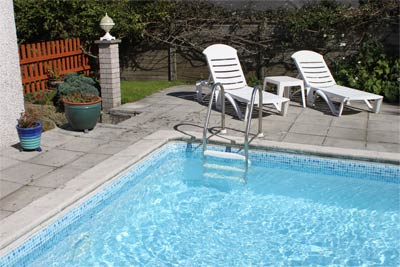 Treloyhan lodge st ives holiday cottages porthminster beach treloyhan lodge retired page for Holiday cottage cornwall swimming pool